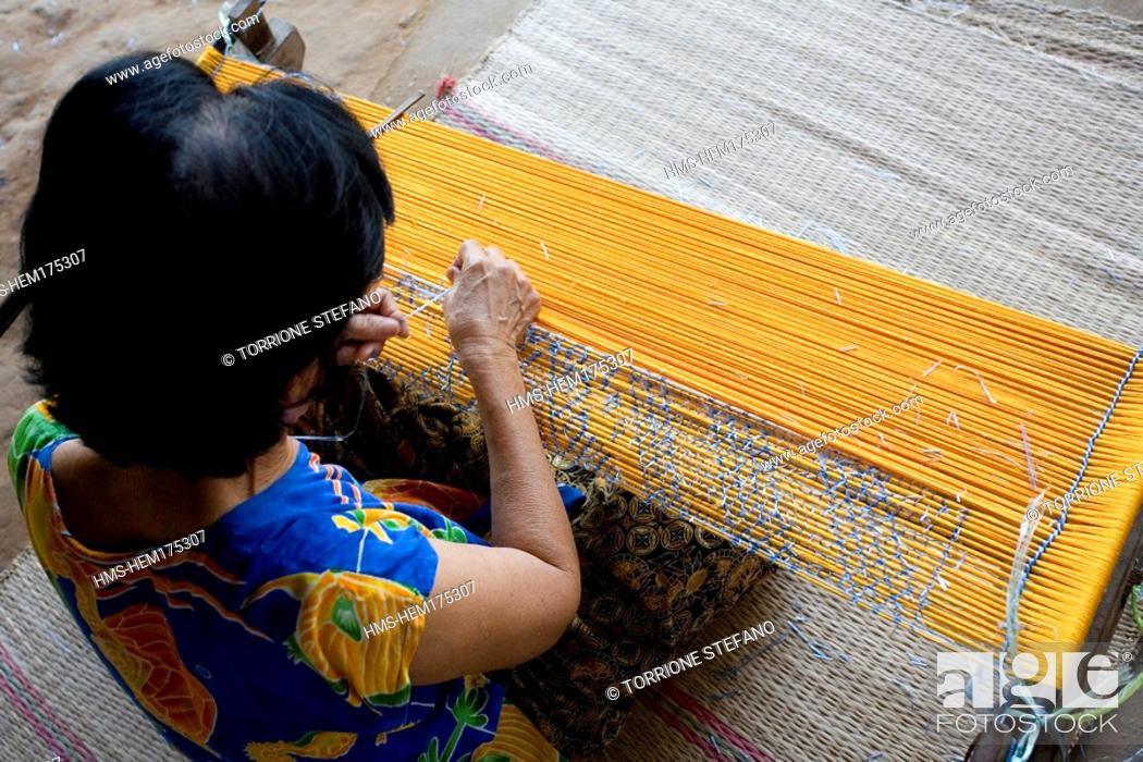 Stock Photo: Thailand, Northeastern Thailand, Isan region, Khon Kaen province, Chonnabot, specialised centre for the silk manufacture and the mat mii technique dyeing the.
