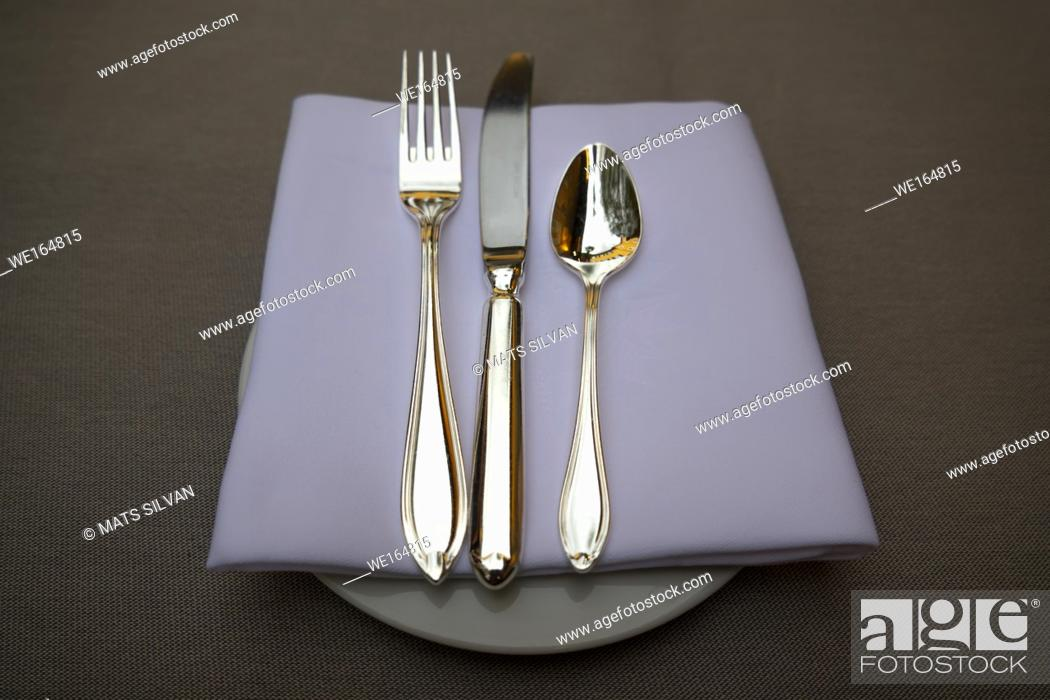 Stock Photo: Silver Eating Utensils on a Plate with Napkin in Ascona, Switzerland.