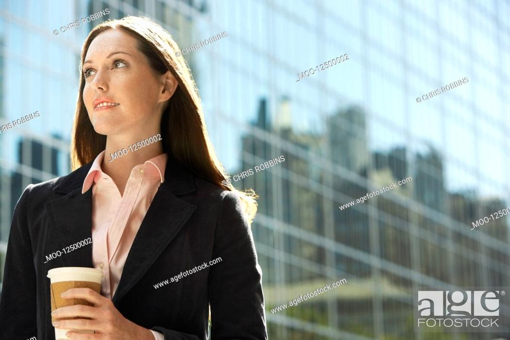 Stock Photo: Office worker with drink outside office building portrait.