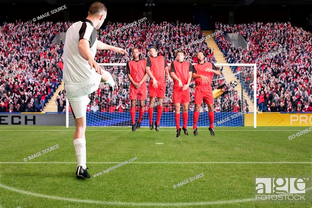 Stock Photo: Football taking a free kick.