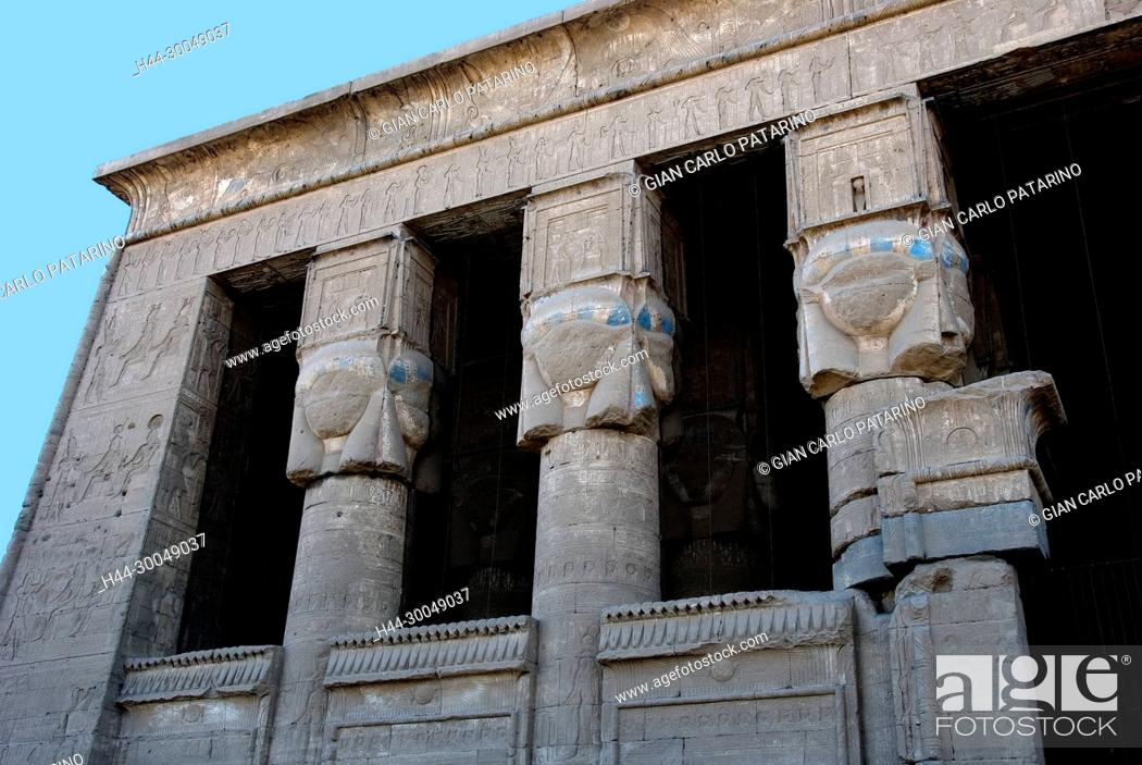 Stock Photo: Egypt, Dendera, Ptolemaic temple of the goddess Hathor.View of external capitols from courtyard.
