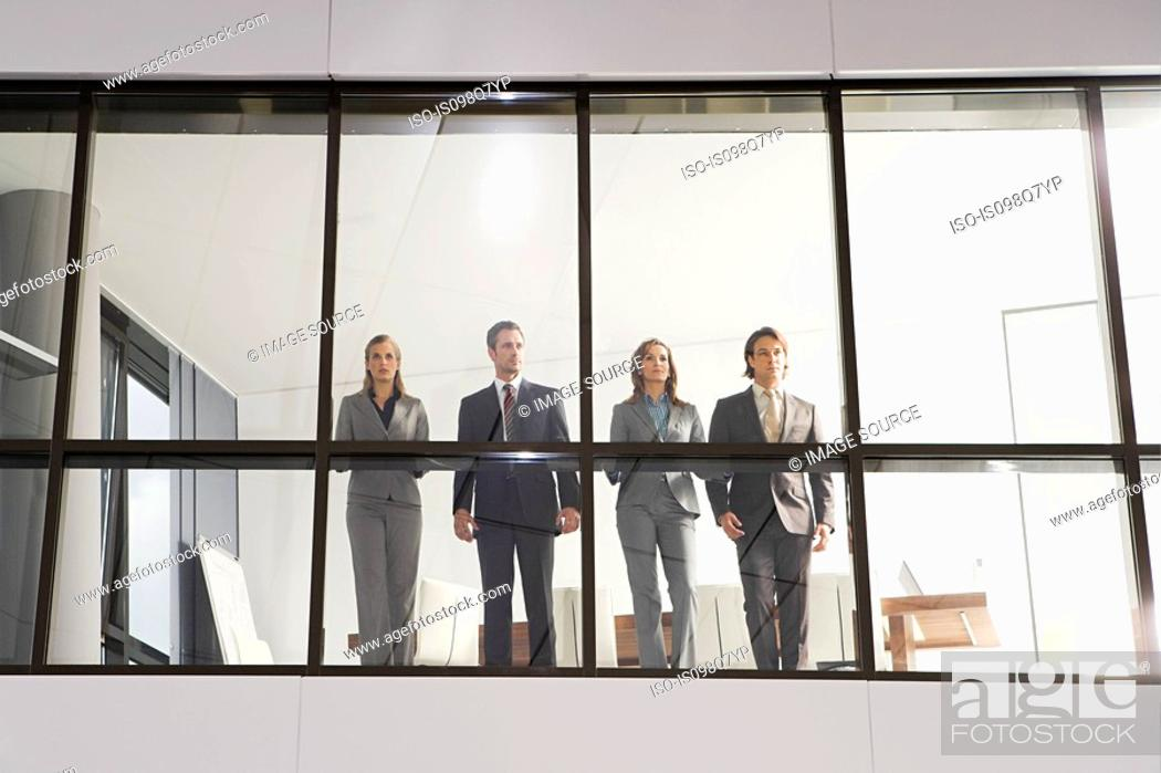 Stock Photo: Businesspeople in office window.