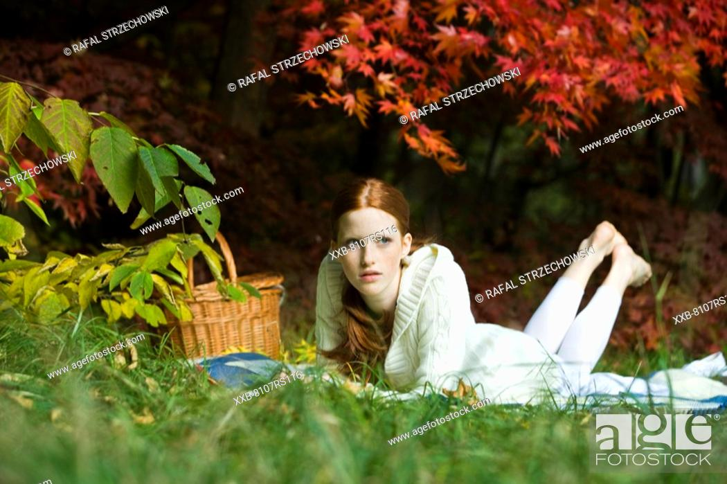 Stock Photo: Young woman relaxing in park.
