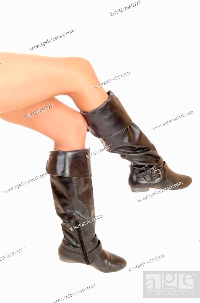 Stock Photo: Legs in boots.