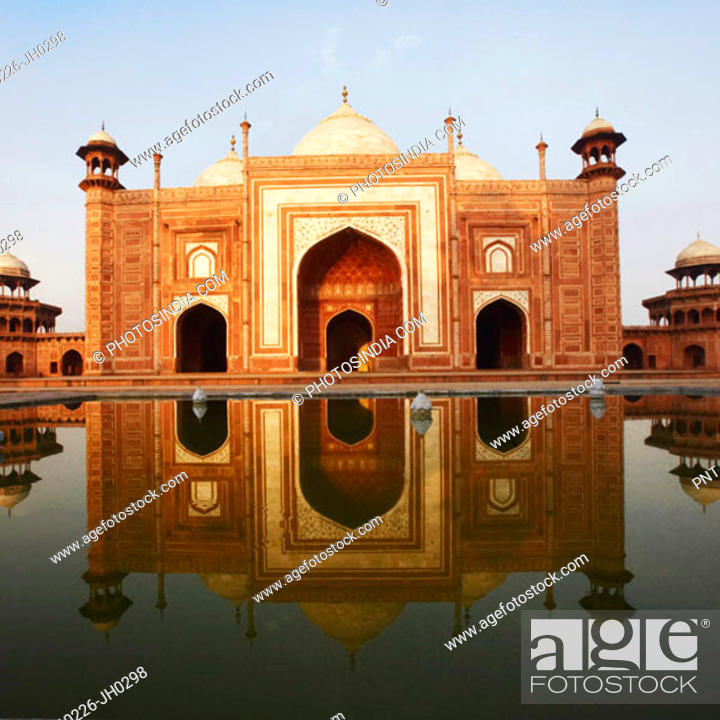 Stock Photo: Reflection of a mausoleum in water, Taj Mahal, Agra, Uttar Pradesh, India.