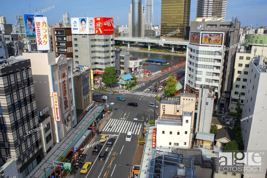 """Stock Photo: Aerial view Skytree, Asahi Flame, Sumida River & Azuma Bridge. Sightseeing ship """"""""Himiko"""""""" of Tokyo Cruise Line at Sumida River at Asakusa in the Tokyo city."""