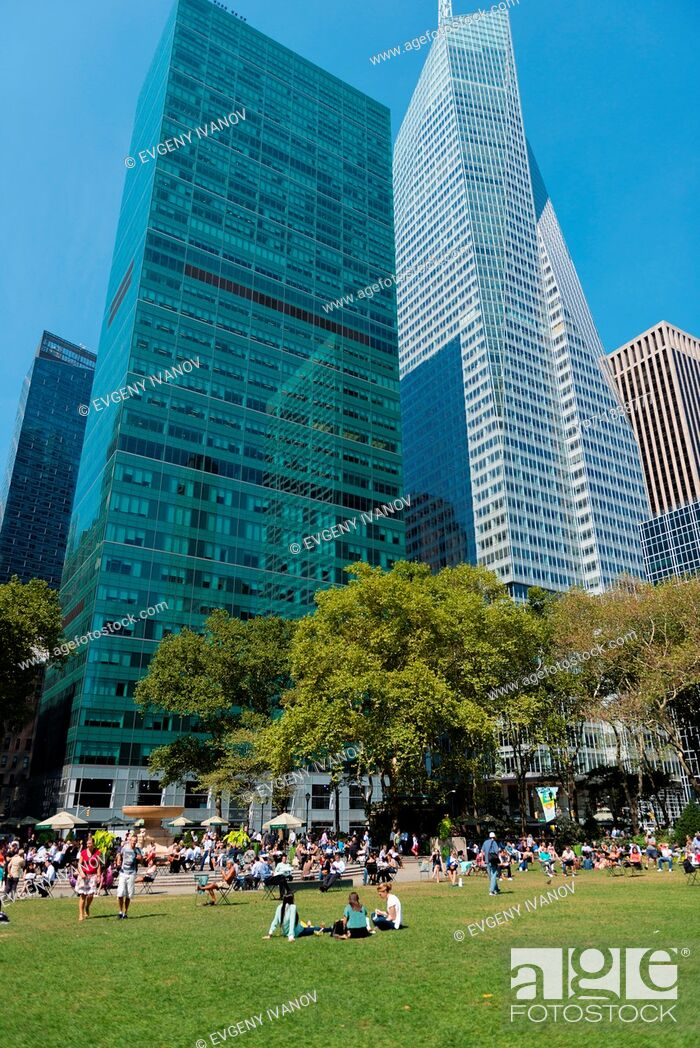 Stock Photo: People relaxing on the lawn in Bryant Park, New York.