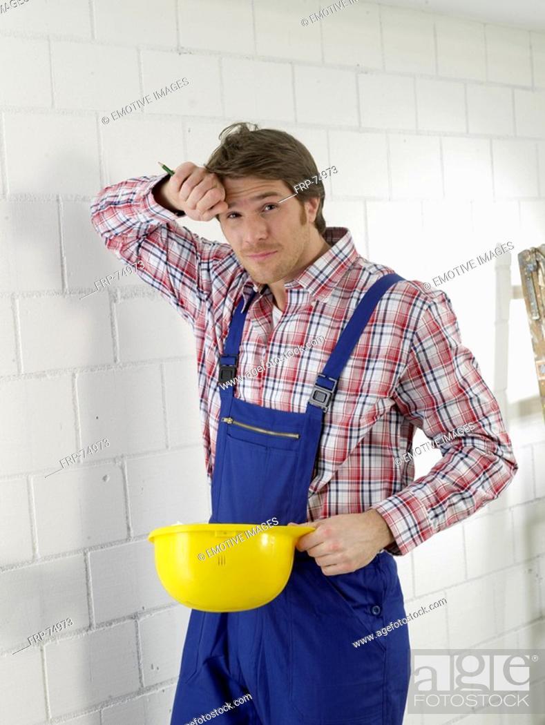 Stock Photo: Construction worker with helmet.