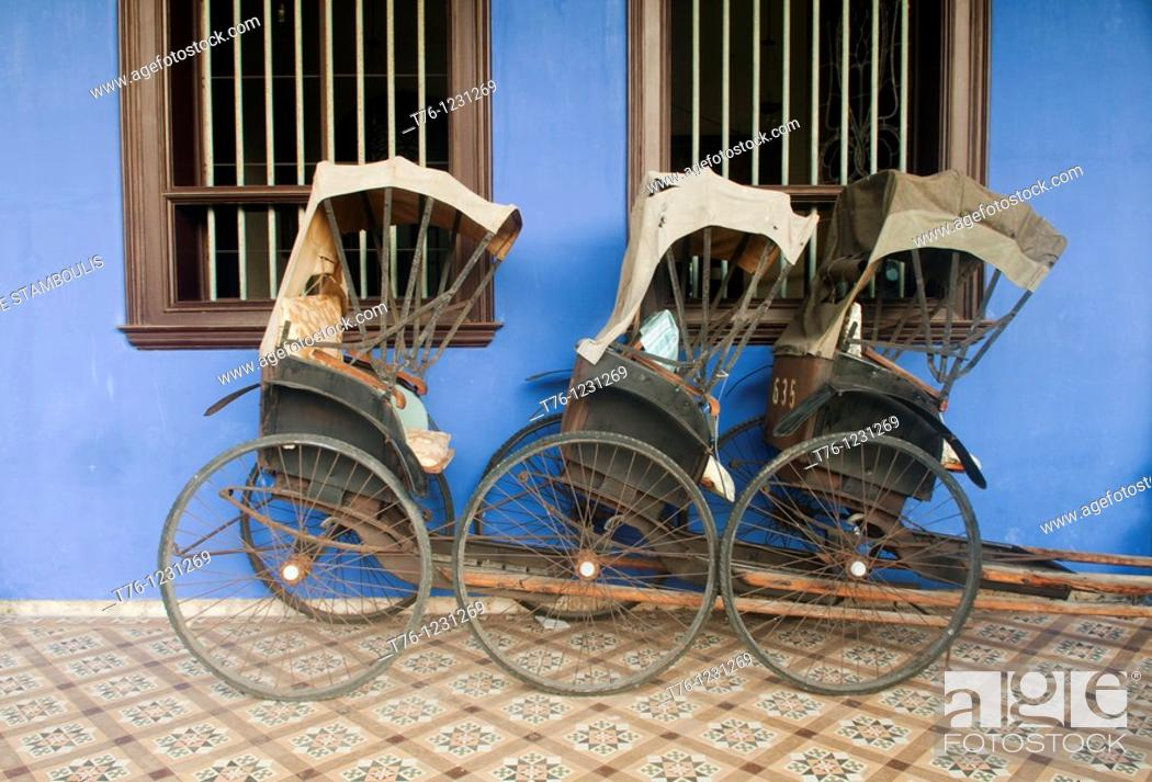 Stock Photo: bicycle rickshaws in front of the Cheong Fatt Tze Chinese Mansion in Georgetown, Malaysia.