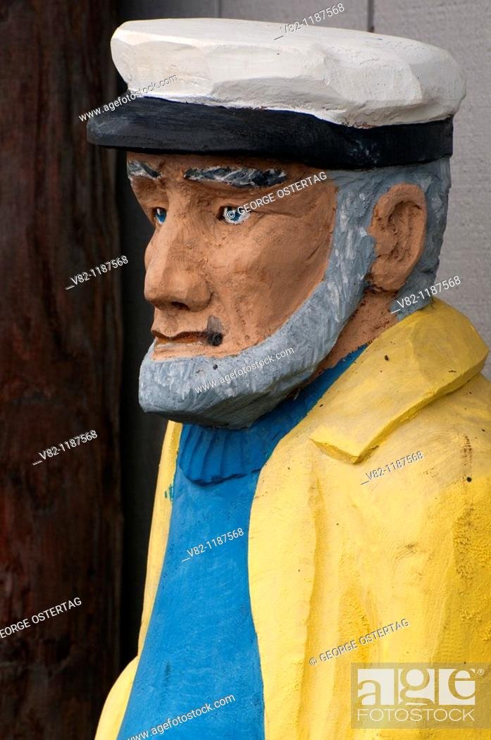 Stock Photo: Fisherman wood carving, Winchester Bay, OR.