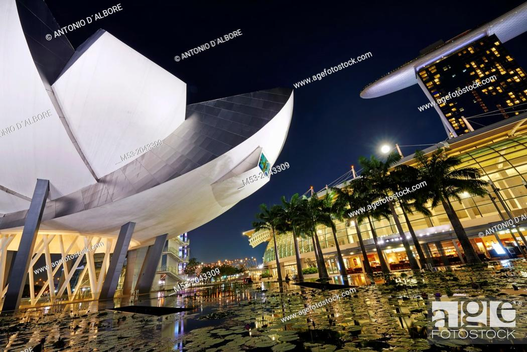 Stock Photo: The flower shaped Art Science Museum located in the Marina Bay Sands Complex. In the right had side of the image The Shoppes.