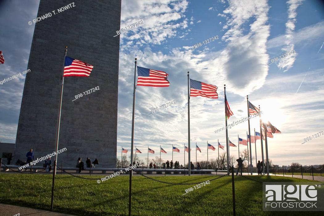 Stock Photo: Flags flying around the Washington Monument.