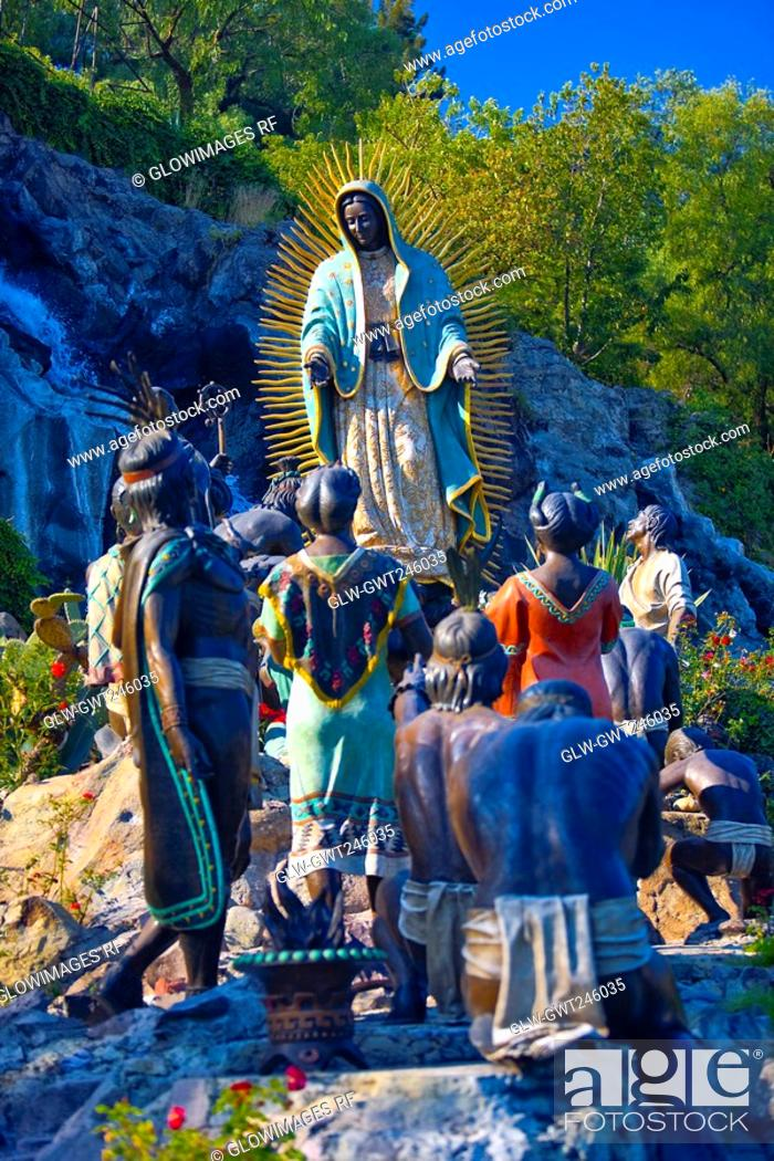 Stock Photo: Low angle view of statues on a rock, Virgin of Guadalupe, Tepeyac, Mexico city, Mexico.