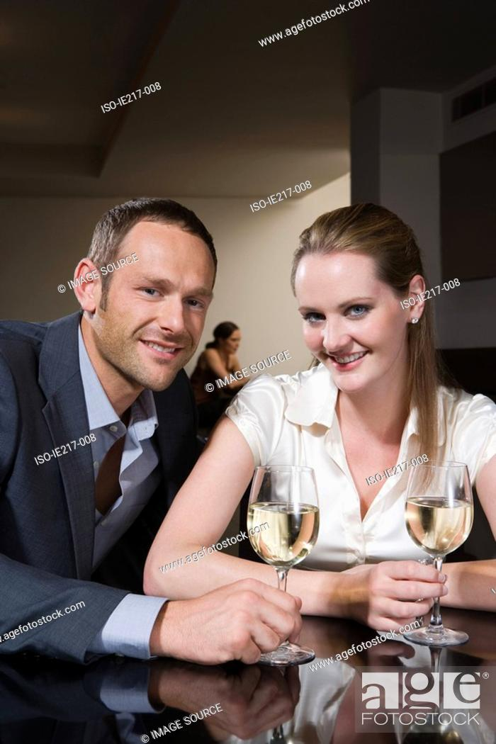 Stock Photo: Couple drinking wine in a bar.