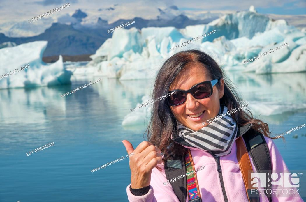 Stock Photo: Woman smiling visiting Jokulsarlon Glacier Lagoon in summer, Iceland.