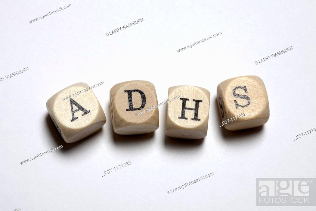 Stock Photo: Lettered cubes spelling ADHS, the German acronym for Attention Deficit Hyperactivity Disorder.