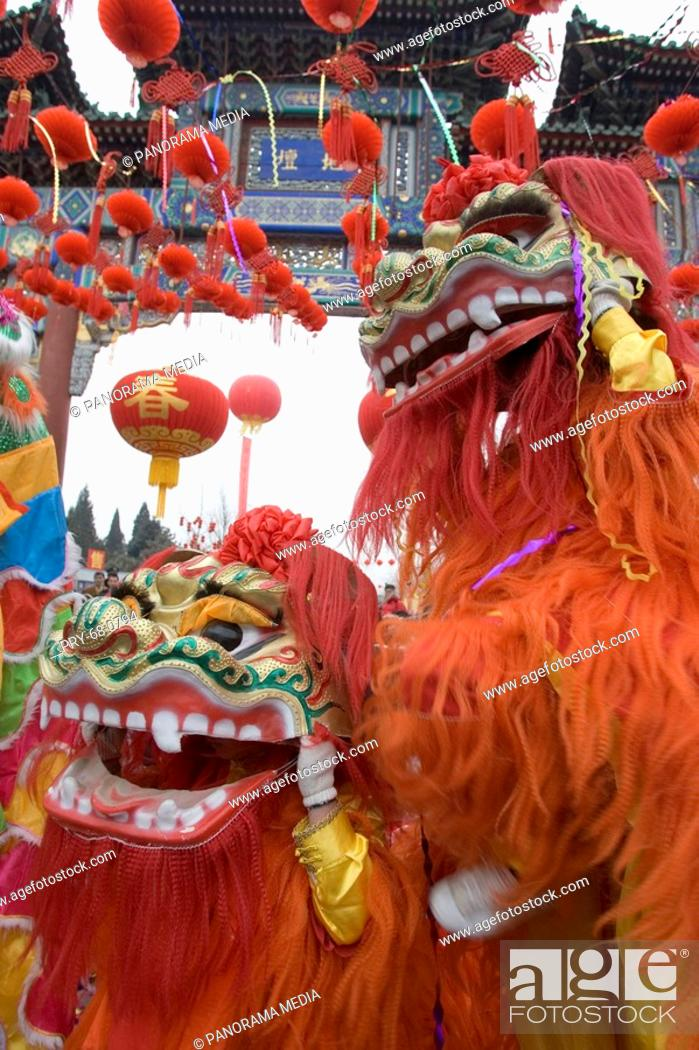 Stock Photo: Two man-made lions dancing in temple fair.