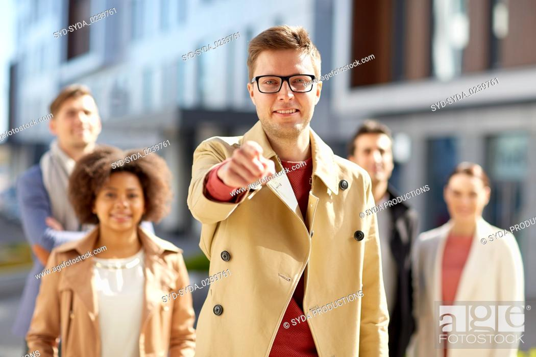Stock Photo: businessman pointing finger over people on street.