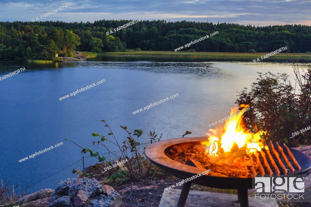 Stock Photo: Stockholm, Sweden A campfire by the lake Malaren.