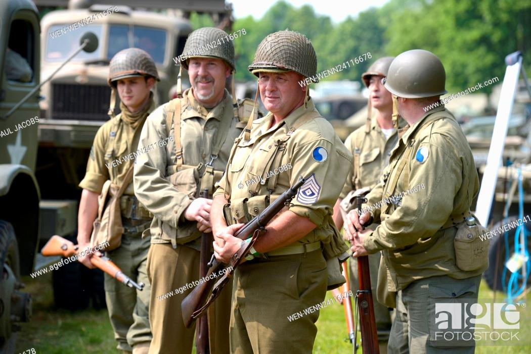 Stock Photo: Pictured on a warm bank holiday weekend is the Solent Overlord WW2 show in Denmead, Hampshire, UK. The show attracts over 4000 visitors over the weekend with.