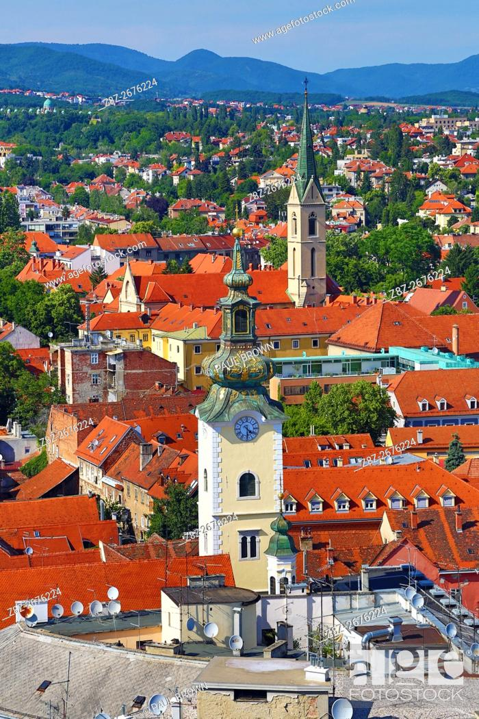 Stock Photo: Aerial view of rooftops and the towers of St Mary's Church and St Francis Church in Zagreb, Croatia.
