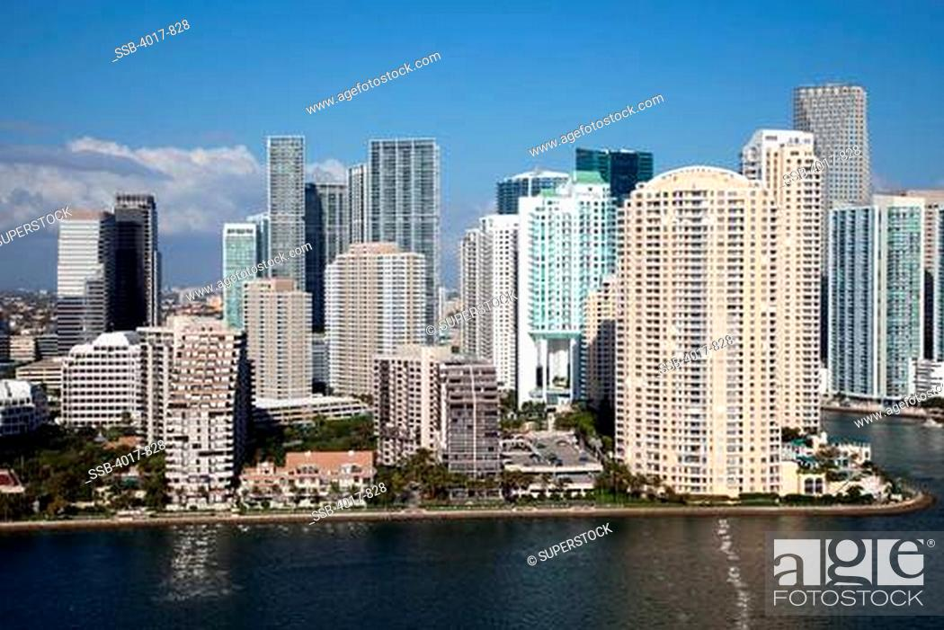 Stock Photo: Aerial of Brickell Key Skyline in Miami from over Biscayne Bay.
