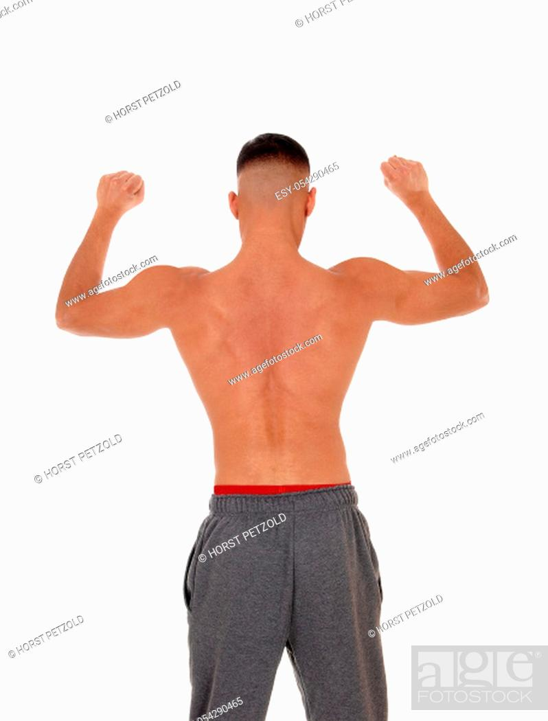 Stock Photo: A handsome young east Indian man standing shirtless from the back.in track pants with red underwear, isolated for white background.