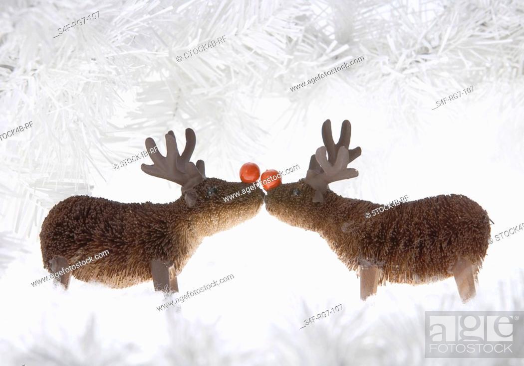 Stock Photo: Two reindeer figurines.