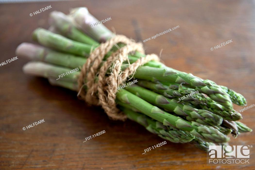 Stock Photo: A bundle of asparagus.