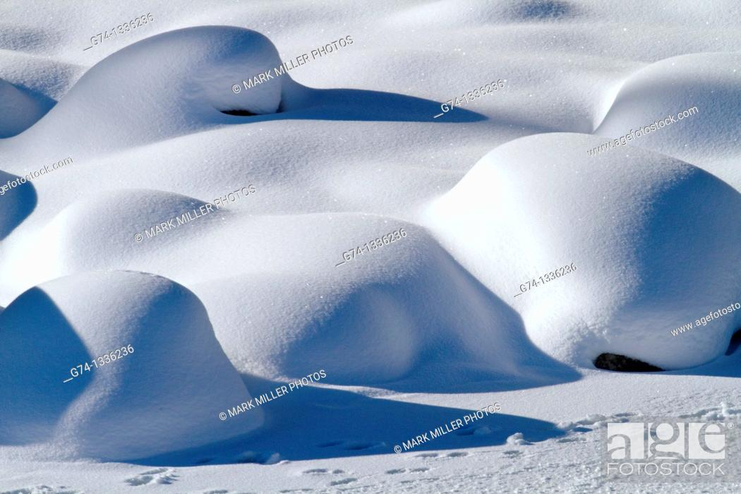 Stock Photo: Winter Snow Patterns on River Rocks Yellowstone National Park.