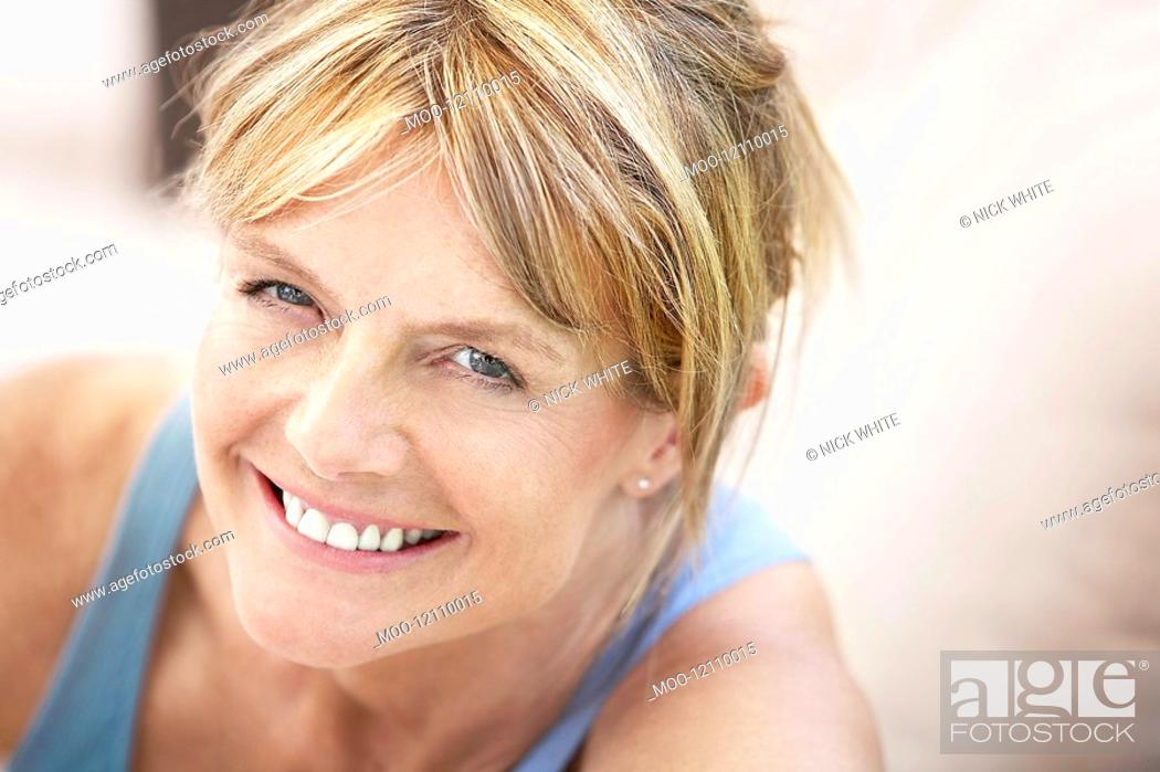 Stock Photo: Middle-aged woman smiling portrait.