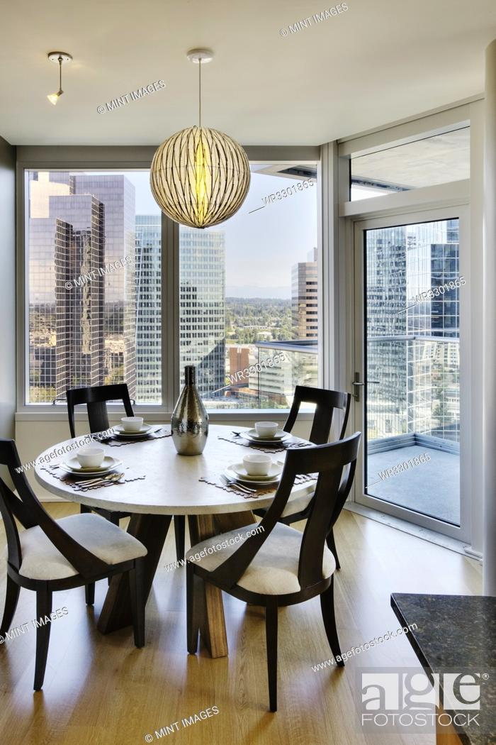 Stock Photo: Dining room in luxury highrise apartment.