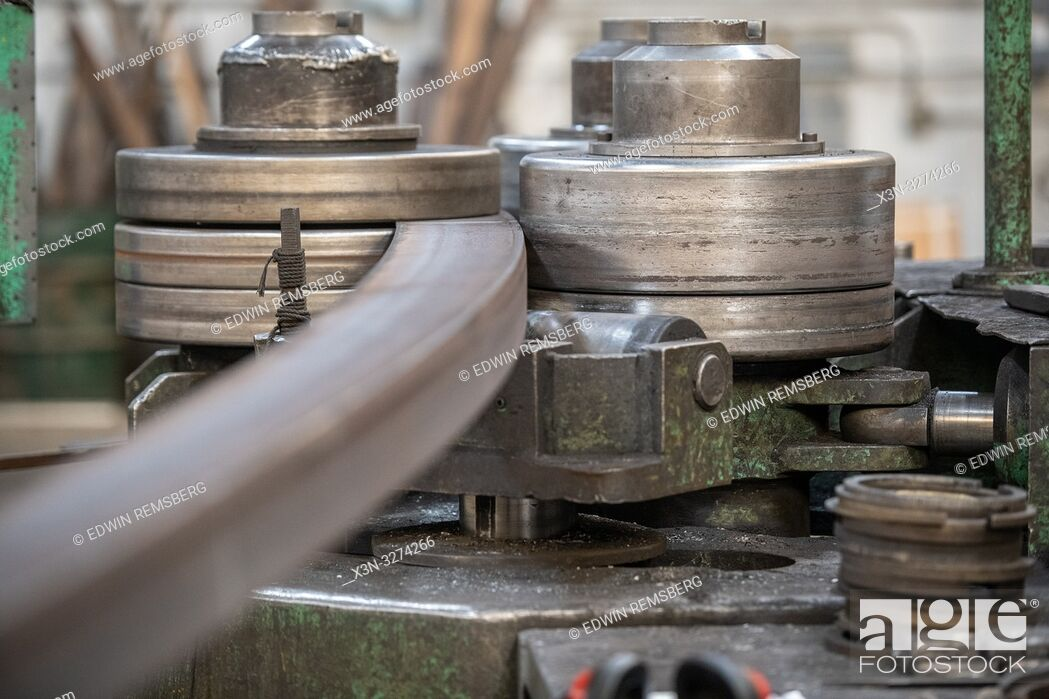 Stock Photo: Machine rolling steel into a curve at metal bending shop, Dundalk, Maryland.