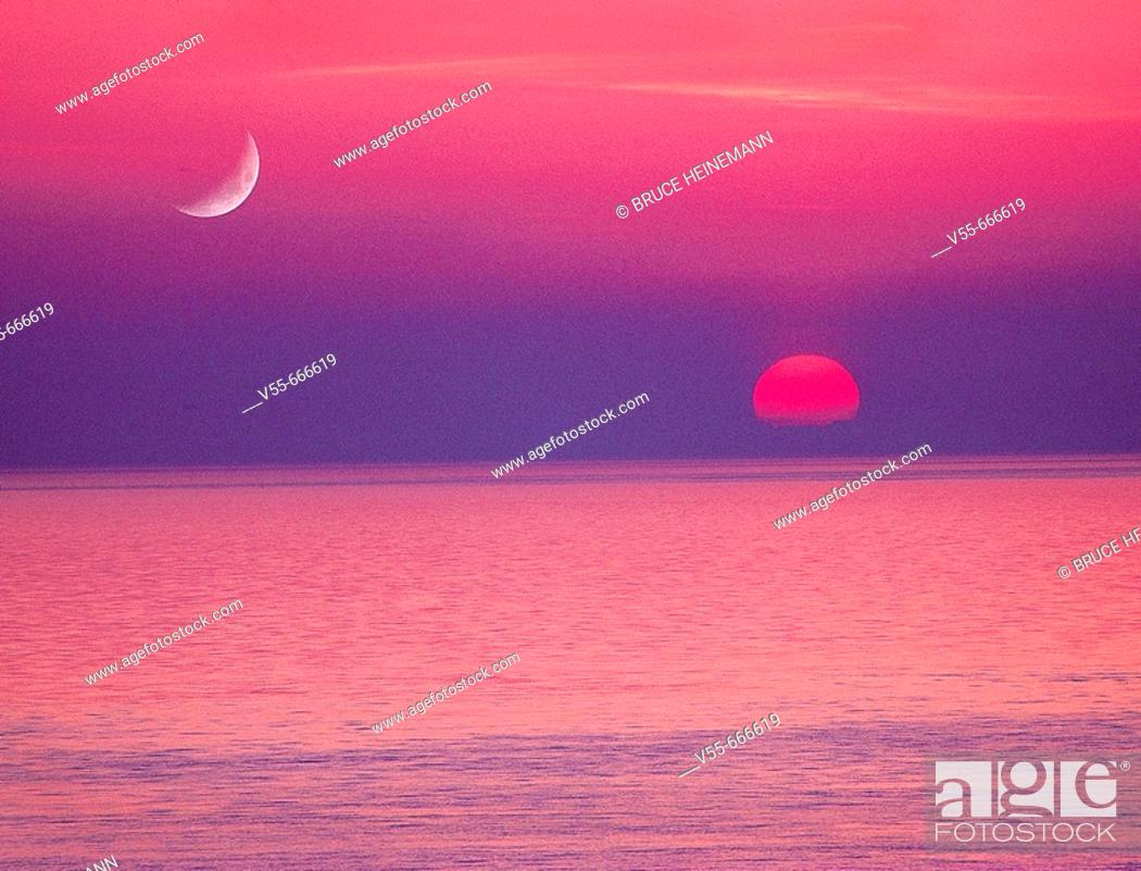 Stock Photo: Moon and setting sun over Straits of Juan De Fuca, from San Juan Island, Washington State, USA.