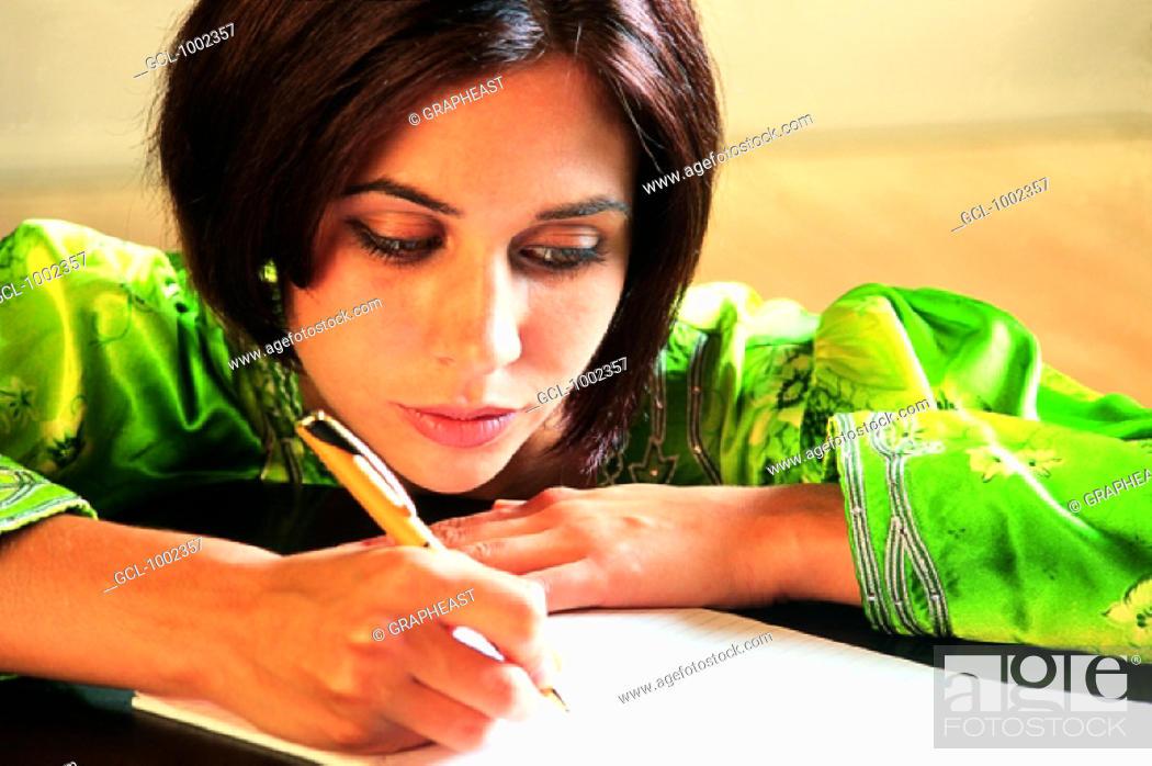 Stock Photo: Student writing.