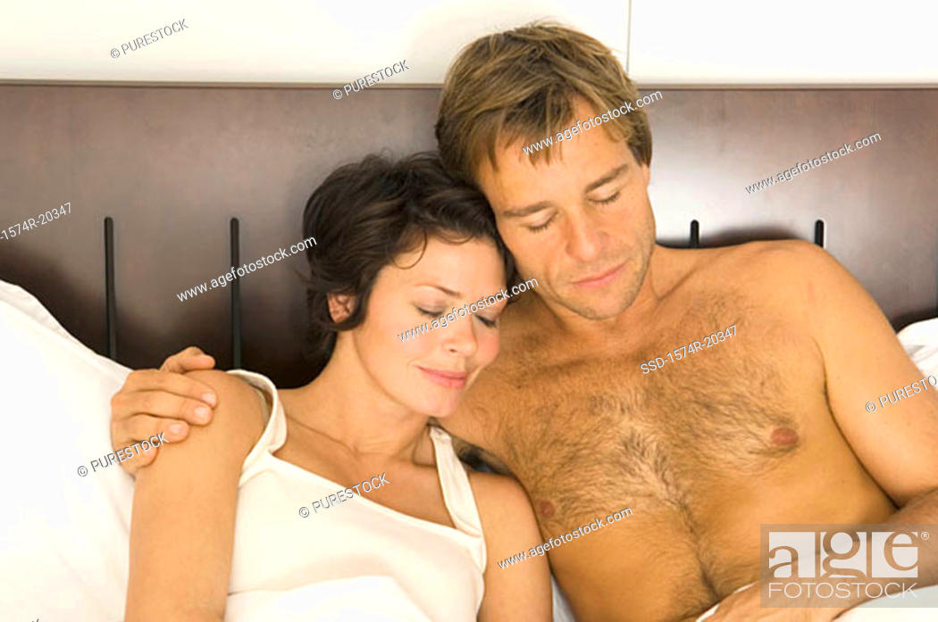 Stock Photo: Close-up of a young couple sleeping in bed.