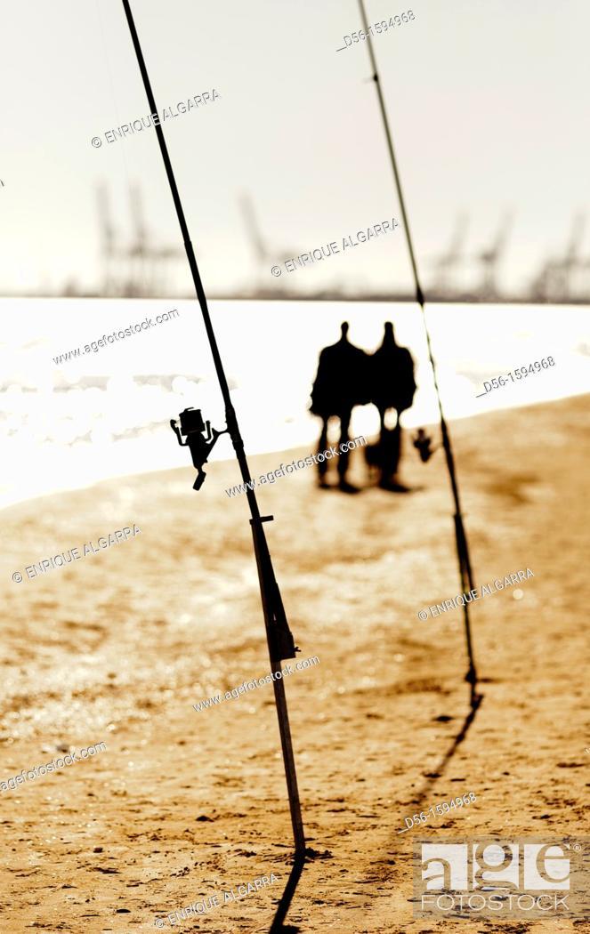 Stock Photo: couple walking in the beach, Malvarrosa beach, Valencia, Spain.