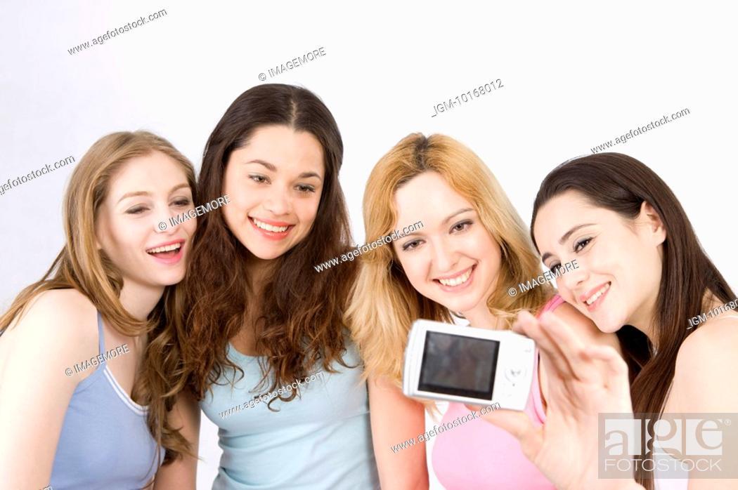 Stock Photo: Four women taking self-portrait.