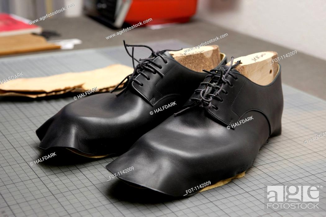Stock Photo: A pair of shoes being made.