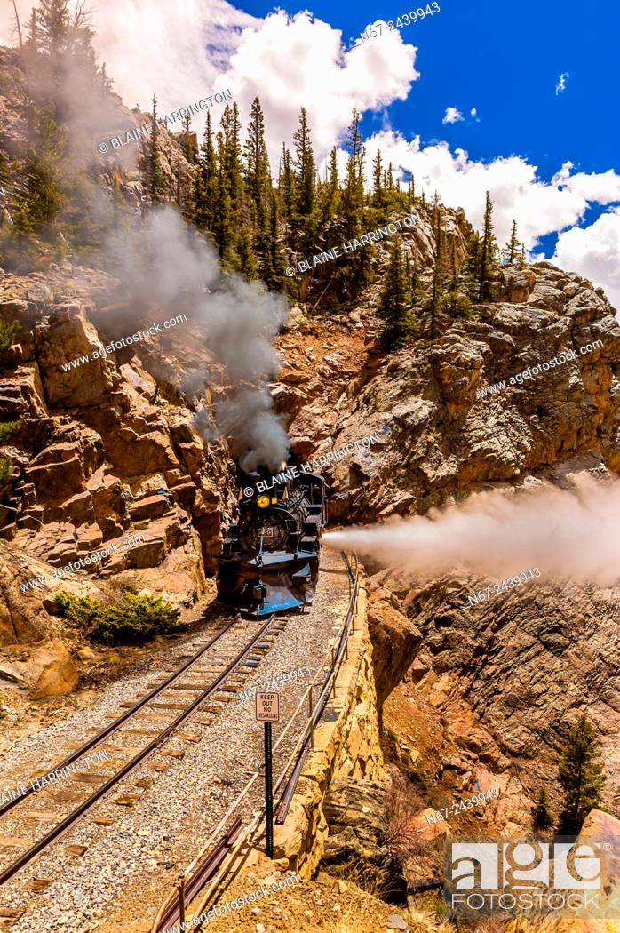 Stock Photo: The Cumbres & Toltec Scenic Railroad train pulled by a steam locomotive comes out of a tunnel at 9669 feet on the 64 mile run between Antonito.