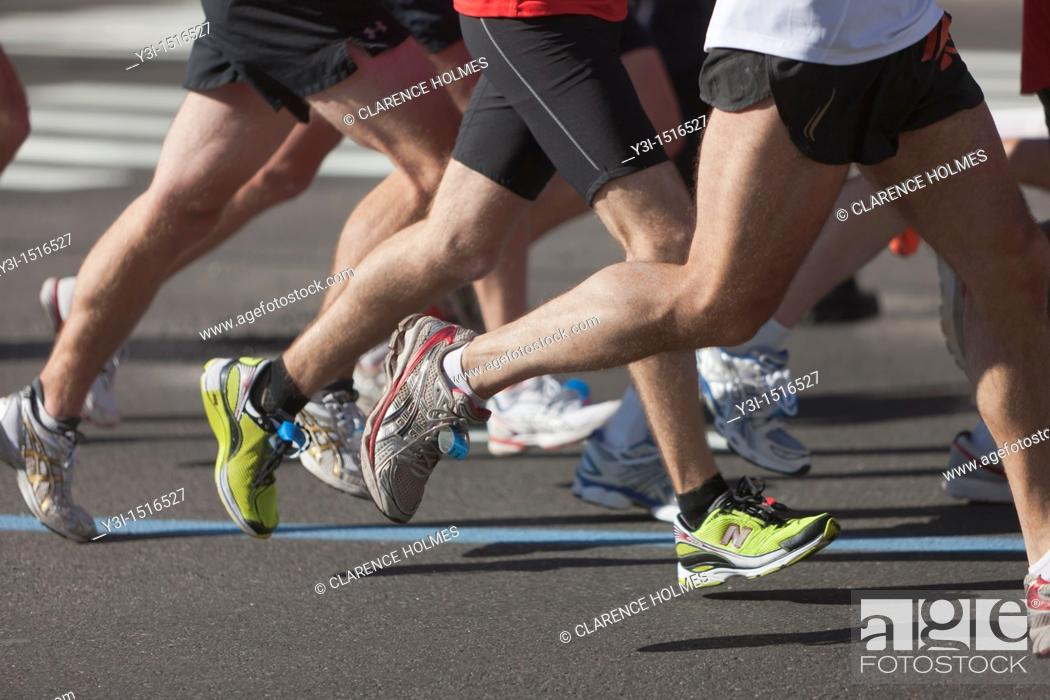 Stock Photo: NEW YORK - NOVEMBER 7: The legs and feet of runners during the 2010 New York City Marathon.