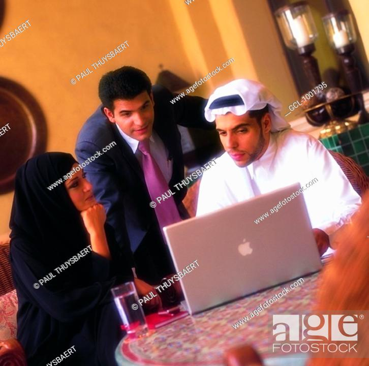 Stock Photo: Businesspeople using a laptop.