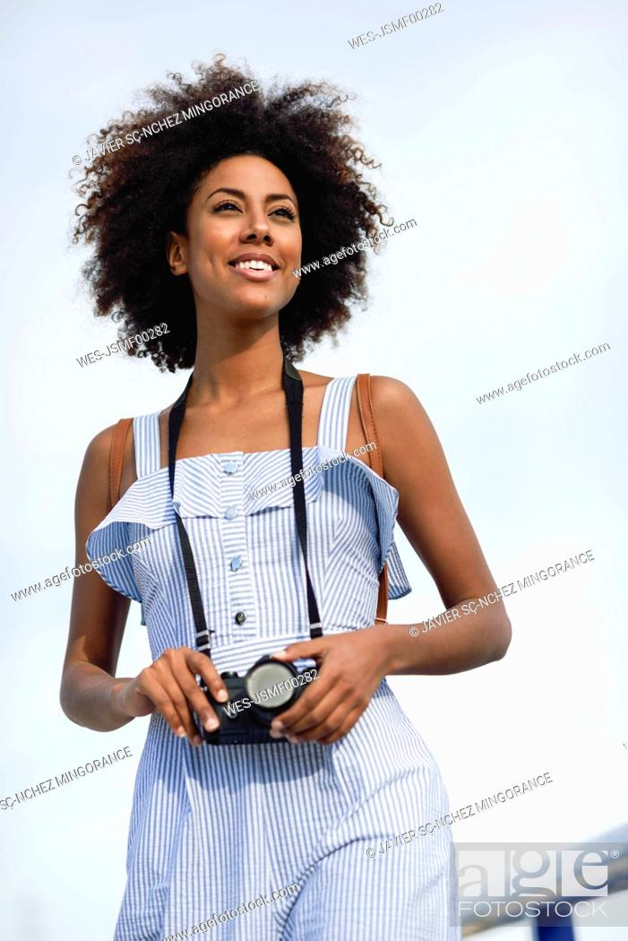 Stock Photo: Portrait of fashionable young woman with curly hair.