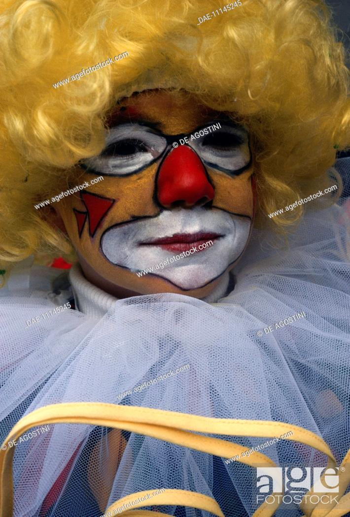 Stock Photo: Child with painted face dressed as a clown, Carnival of Binche (UNESCO Intangible Cultural Heritage, 2008), Hainaut, Belgium.