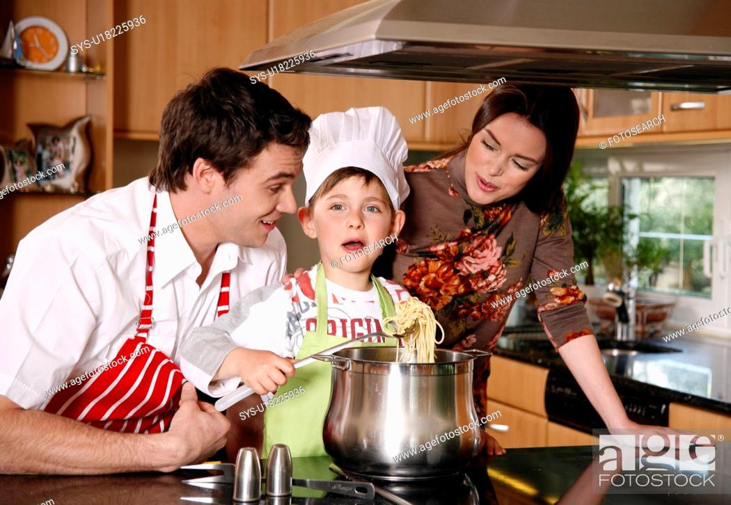 Stock Photo: Parents and son cooking spaghetti.