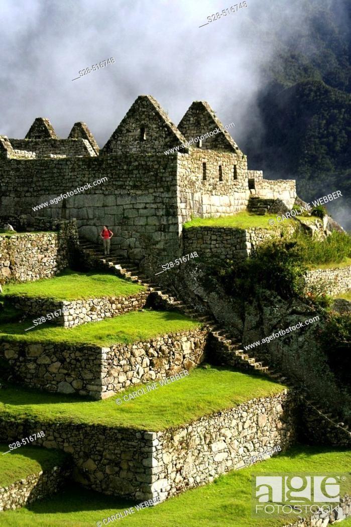 Stock Photo: Woman on stairs at Machu Picchu.