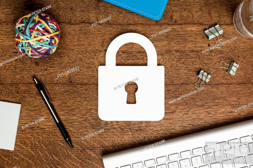 Stock Photo: View from above paper padlock on wooden desk.