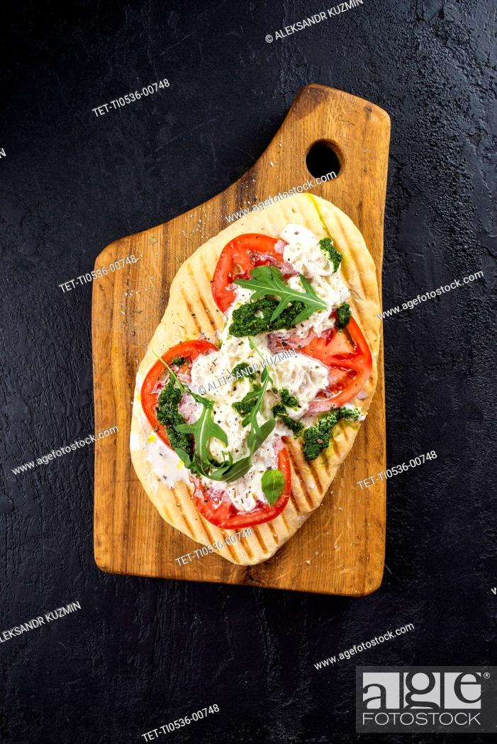 Stock Photo: Bread topped with tomato and fish.