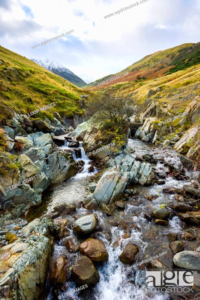 Stock Photo: Glenridding Beck with a snow capped Catsty Cam beyond in the Lake District National Park.