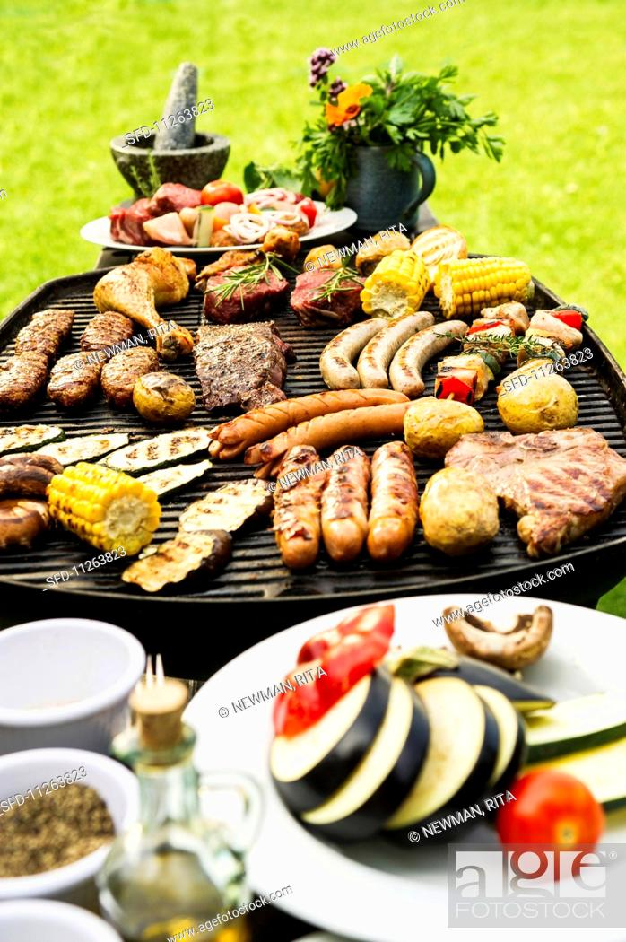 Stock Photo: A summer barbecue in a garden.